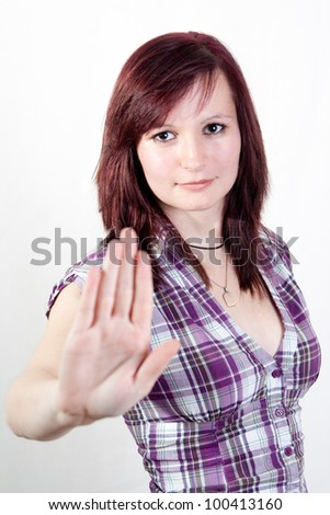 young redhead woman is showing the stop gesture - isolated on white background - stock photo