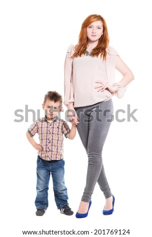 Young redhead woman posing with her little son. Isolated on white - stock photo