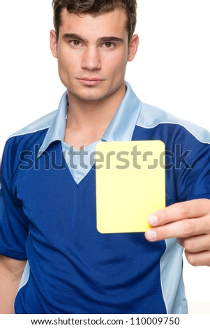Young  referee with yellow card in front of white background - stock photo