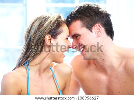 Young relaxed couple in jacuzzi. Spa.