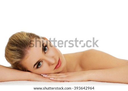 Young relaxed woman based on table. - stock photo