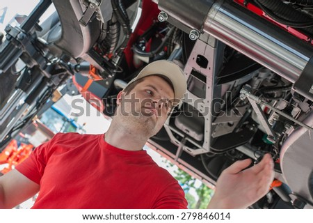 young repairman looking for a problem - stock photo