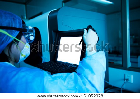 young researcher works in chemistry laboratory. - stock photo