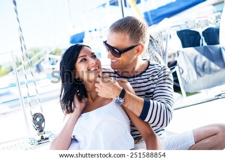 Young, rich and attractive couple on a sailing boat - stock photo