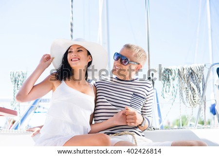 Young, rich and attractive couple on a sailing boat at summer - stock photo