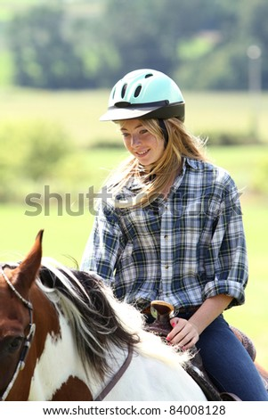 Young rider on the move - stock photo