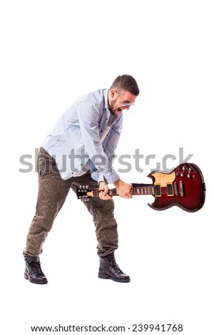 young rock musician wants to smash a guitar - stock photo