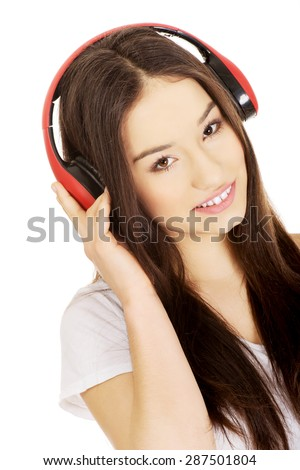 Young rock woman with headphones listening to music. - stock photo