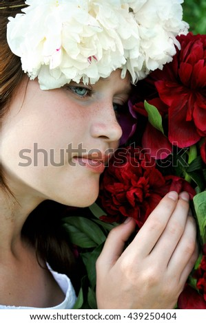 Young, romantic, beautiful girl with flowers . - stock photo