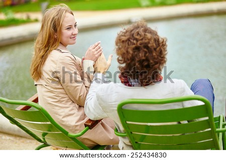 Young romantic couple having a date in the Tuileries garden of Paris