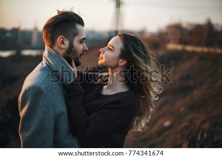 young romantic couple in love. industrial autumn landscape