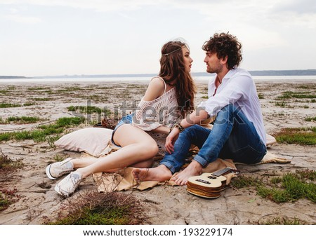 Young  romantic couple in love outdoor - stock photo