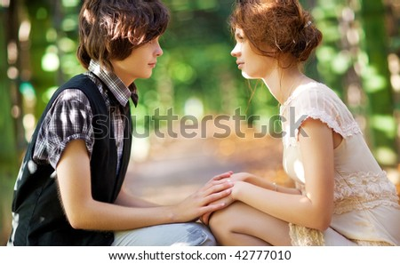 Young romantic couple looking to each other. - stock photo