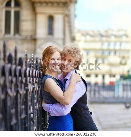 Young romantic couple outdoors in Paris, having fun - stock photo