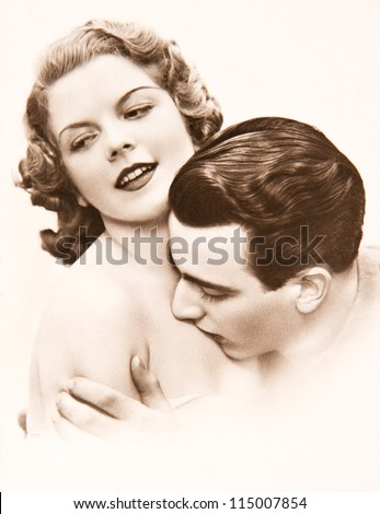 young romantic erotic sexy couple. old sepia picture ca. 1920 - stock photo