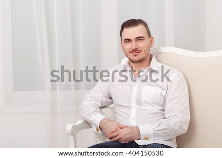 Young romantic man in white shirt. Men's fashion. Shirt with cufflinks.