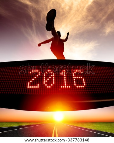 young runner jumping and crossing 2016 display  - stock photo