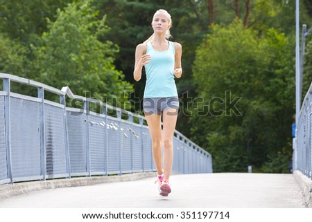 Young running woman trains her stamina outdoor - stock photo