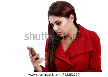 Young sad girl reading text message on her telephone - stock photo