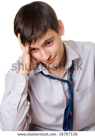 Young sad man in blue tie on white background