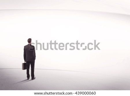 Young sales business male in elegant suit standing with his back in empty white space background with lines concept - stock photo