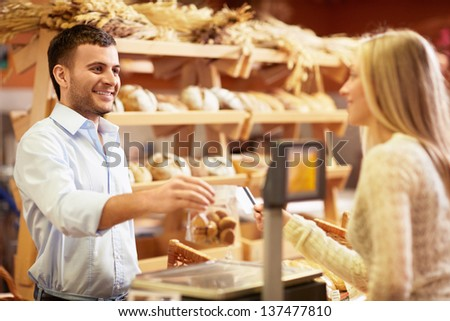 Young salesman behind the counter - stock photo