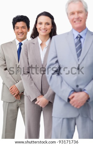 Young salespeople together with mentor against a white background - stock photo