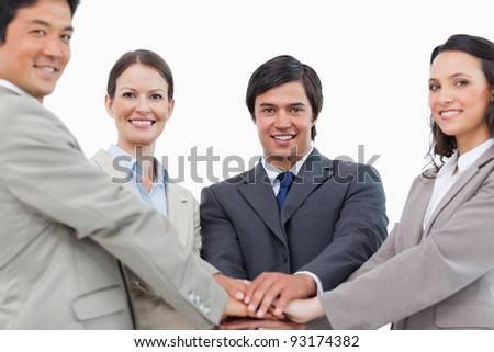 Young salesteam motivating each other against a white background