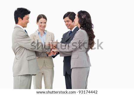 Young salesteam self-motivating against a white background