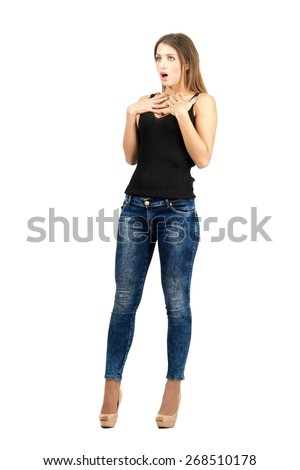 Young scared shocked woman looking away. Full body length portrait isolated over white background.  - stock photo