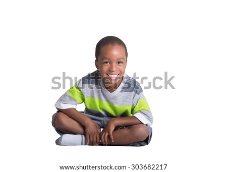 Young school aged boy isolated on white