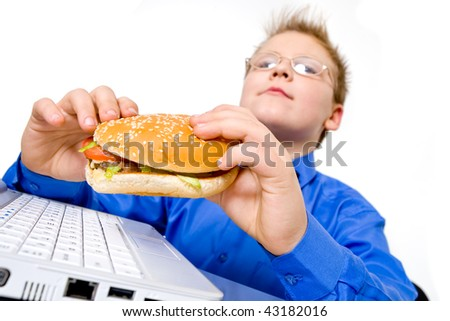 Young school boy with hamburger, isolated on white