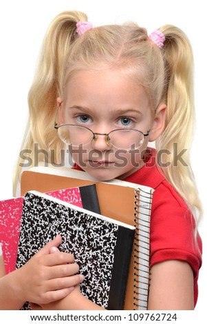 young school girl holding books - stock photo