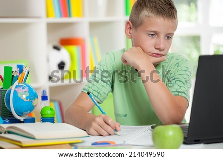 young schoolboy studyng at home - stock photo