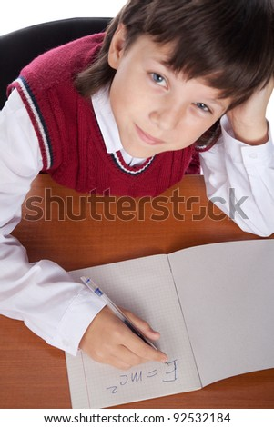 young schoolboy writing formula in the - stock photo