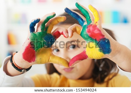 young schoolgirl hands forming a heart symbol, Selective Focus, Focus is on the hand - stock photo