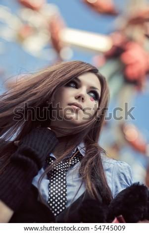 Young schoolgirl in amusement park. Focus on face. - stock photo