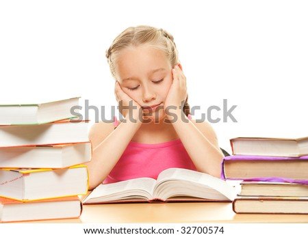 Young schoolgirl reading a book