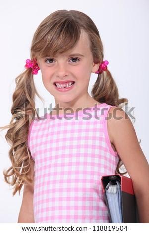 Young schoolgirl showing her teeth - stock photo