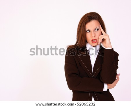 Young schoolgirl thinking pose - stock photo