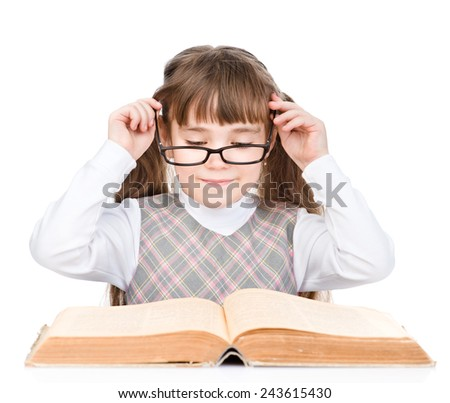 young schoolgirl with glasses read book. isolated on white background - stock photo