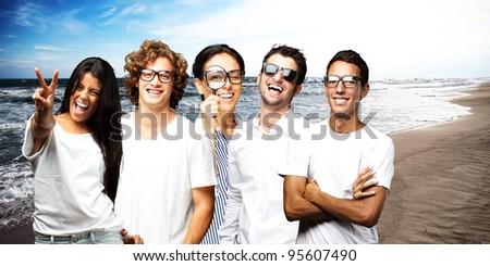 young scientific team enjoying near the sea shore - stock photo