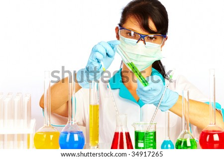 Young scientist in laboratory with test tubes - stock photo