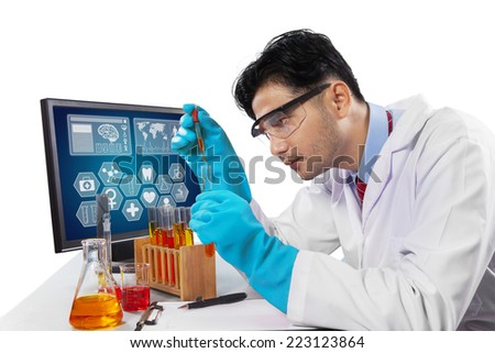 Young scientist student using chemical fluid for research, isolated on white - stock photo