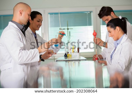 Young scientist works in modern chemistry lab - stock photo