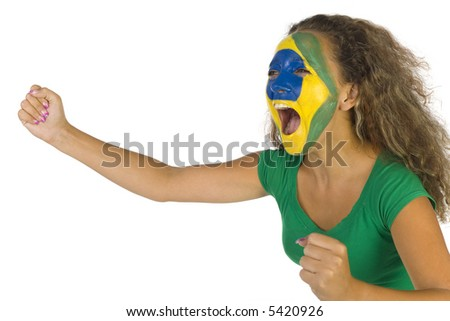 Young screaming Brazilian fan with painted flag on face. White background, side view - stock photo