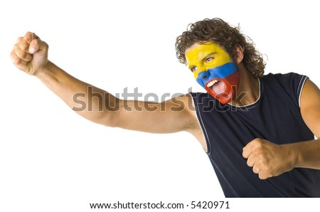 Young screaming Paraguayan fan with painted flag on face. White background, side view - stock photo