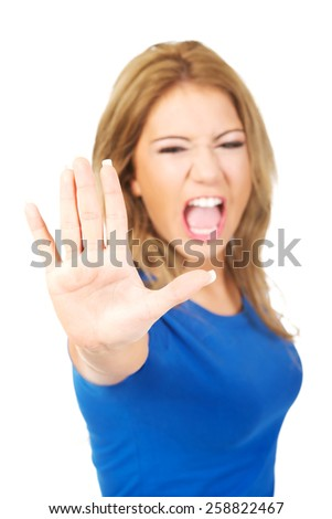 Young screaming woman making stop sign with her hand.