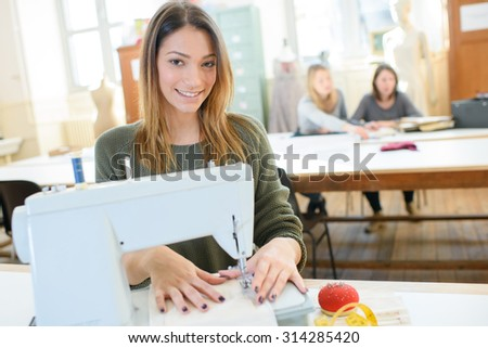 Young seamstress - stock photo