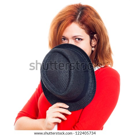 Young secret woman hiding face behind hat, isolated on white background. - stock photo